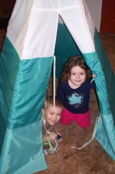 Owen and Jazmine greet me from door of Owen's tent