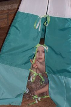 Owen peeking out from his tent doors